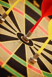 Arrow hit black and yellow Bullseye. Centre while two miss Royalty Free Stock Images