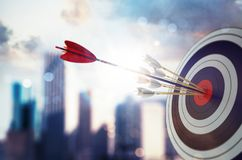 Arrow hit the center of target with modern skyscraper background. Business target achievement concept. 3D Rendering. Target hit in the middle by arrow. Business vector illustration
