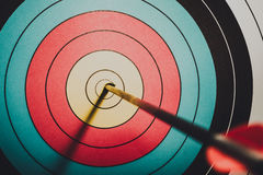 Arrow hit goal ring in archery target. Vintage style stock images
