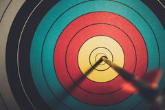 Arrow hit goal ring in archery target. Vintage style stock photography