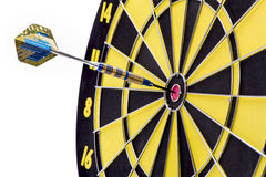 Arrow hits bullseye as symbol for success Stock Photo