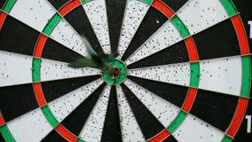 Arrow hits target bullseye in darts stock video footage