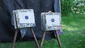 Arrow hits the target. Clip. Bow Arrows hitting a bullseye target at archery bow