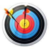 Arrow hits target, one missed. Arrow hits archery target, one missed stock image