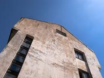 Arrow House. An old arrow-shaped house on blue sky background Stock Photos