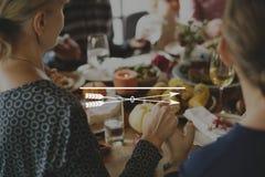 Arrow icon on people having dinner Stock Photo