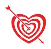 Arrow impale on goal heart Stock Photos