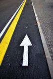 Arrow lane. White arrow lane asphalt road Royalty Free Stock Photos