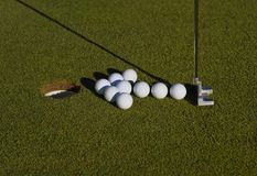 Arrow layout of golf balls Stock Image