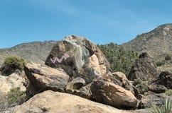 Arrow points to the desert rock murals. Arrow leading you to the rock murals, Chloride, Arizona Stock Photos