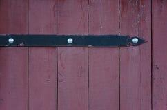 Arrow-like metal decoration on a wooden door Stock Photos