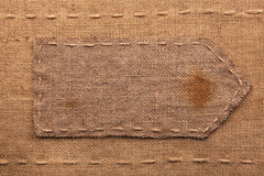 Arrow made of burlap  lies on a sacking  background Royalty Free Stock Photography