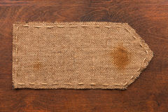Arrow made of burlap lies on a wooden background Royalty Free Stock Photography