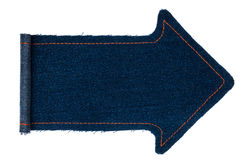 Arrow made from a denim with wrapped edges Stock Images
