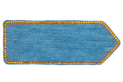 Arrow made of denim with yellow rhinestones, isolated Stock Image