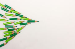 Arrow made with many green pens - business concept Stock Photo