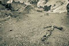 Arrow made with rocks in death valley national Stock Images