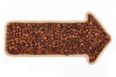 Arrow made of rope with coffee beans Royalty Free Stock Photography