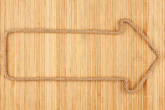 Arrow made of rope  lies on a bamboo mat Stock Image