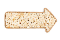 Arrow made of rope with  pumpkin seeds Royalty Free Stock Photo