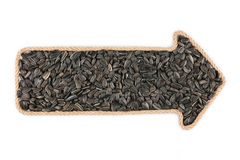 Arrow made of rope with sunflower seeds Royalty Free Stock Image
