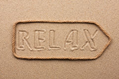 Arrow made of rope with the word relax on the sand Stock Photography