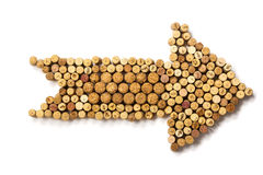 Arrow made of used wine corks. Closeup Arrow made of used wine corks. A random selection of used wine corks, some with vintage years Stock Images