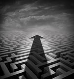 Arrow Maze. Business concept as a cast shadow cutting across a three dimensional labyrinth as a success metaphor and solution symbol for finding an  innovative Royalty Free Stock Image