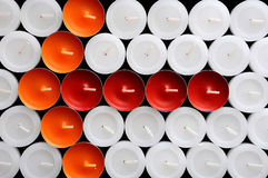 The arrow of the multi-colored candles Stock Images