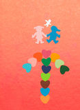 Arrow from multicolored paper hearths  and paper boy and girl with angel Stock Photo