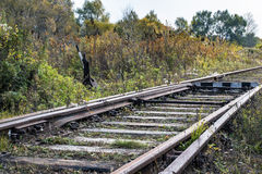 The arrow on the old railway line Stock Photography