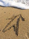 Arrow On Wet Sea Sand Stock Photos