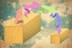 Arrow origami paper texture style down to the box. Isolated on sky background Stock Photo