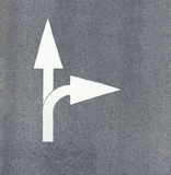Arrow painted on asphalt Royalty Free Stock Photo