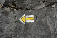 Arrow Painted On Rock Stock Photo