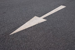 Arrow on the pavement. Arrow indicates the direction on asphalt Stock Image