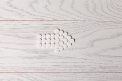 Arrow of pills on table Royalty Free Stock Image