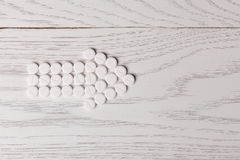 Arrow of pills on table Royalty Free Stock Photography