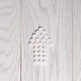 Arrow of pills on table. Arrow of white pills on wooden table Stock Photo