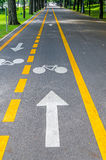 Arrow pointing a bike on a bicycle track Stock Images