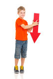 Arrow pointing down. Portrait of cute boy holding red arrow pointing down Royalty Free Stock Image