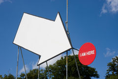 Arrow pointing to sign. Large white arrow pointing to a circular red sign royalty free stock photography