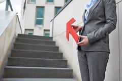 Arrow pointing to stairs upwards Stock Photo