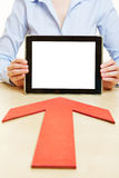 Arrow pointing to tablet computer Royalty Free Stock Photo
