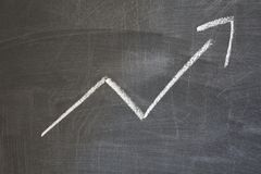 Arrow pointing upward. On black board background. Concept of revenue increase, stock or business growth stock images