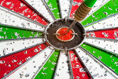 Arrow red & green bullseye dart board target game. Hit red & green bullseye dart board target game Royalty Free Stock Photography