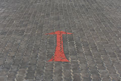 Arrow red sign paint on road Royalty Free Stock Photos