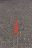 Arrow red sign paint on road Royalty Free Stock Photography