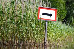Arrow by the reeds Stock Photography