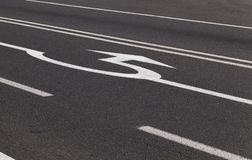 Arrow on the right. On the road near the roundabout. close-up photo royalty free stock photos